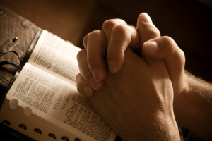 hand of a person praying