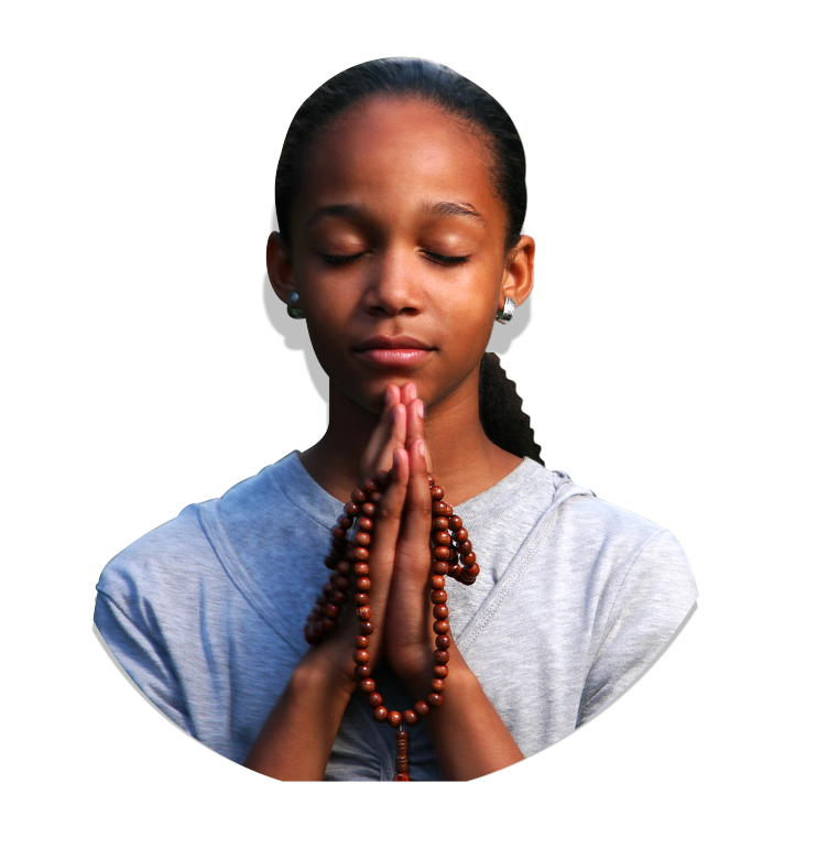 A girl praying and holding a rosary bead